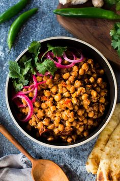This authentic Chana Masala Recipe can be made in an Instant pot or on the stove top. A quick and easy Vegetarian dinner recipe that is full of amazing Indian flavor! Easy Vegetarian Dinner, Tofu Dishes, Simply Recipes, Roasted Sweet Potatoes, Indian Food Recipes, Instant Pot, Healthy, Vegan Foods, Recipes