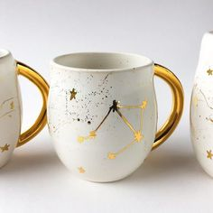 Constellation Mug in White and 22k Gold I throw these mugs on the wheel, fire them in the kiln and hand paint teeny tiny stars it in 22k gold. Holds approximately 12oz. Please message me with any questions. Thank you
