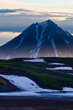 Volcano in Kamchatka, Russia. The Kamchatka Peninsula is a 1,250-kilometre peninsula in the Russian Far East. It lies between the Pacific Ocean to the east and the Sea of Okhotsk to the west. The Kamchatka River and the surrounding central side valley are flanked by large volcanic belts containing around 160 volcanoes, 29 of them still active.