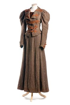 Woman's two-piece brown wool tweed dress, c. 1895. Ornamented with brown braid, the bodice has huge leg-of-mutton sleeves, popular in the 1890s. The smooth, gored skirt was favored by the modern woman, making activity – both at work and at play – easier. From The Charleston (South Carolina) Museum's Seasonal Fashion: Autumn exhibit.