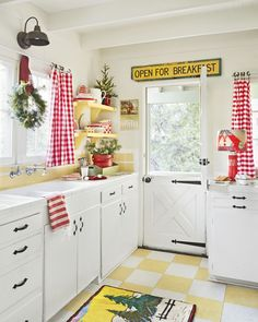 Plaid curtains and a hanging wreath add Christmas charm to this kitchen.