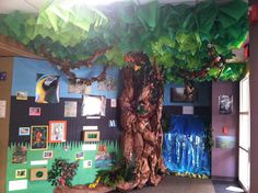 Built a Rainforest in the school library. Definitely needs 3 people to complete! Use T pins or ball pins to hold up tissue paper pieces. No need to cut into leave shapes, when it hangs down it looks like leaves. Tree trunk was constructed by taking 2 long pieces of butcher paper, adding crumpled newspaper and stapling sides. Then crunching it as we stapled it to the wall. Make at least 7-8 pieces of this intertwined and it's look like a giant amazon tree. Added touch boxes to the wall with…