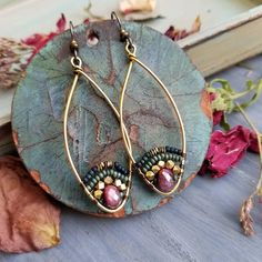 These fabulous lightweight earrings feature faceted mystic-coated Fuschia Moonstone gemstone beads, glass seed beads, brass metal beads, gold and brass wire, hypoallergenic artisan niobium earwires Length: approx 3 inches and VERY lightweight; the wire hoops are approx 50mm long. Buyer