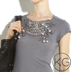 alice + olivia Embellished Asymmetrical Tee In pristine pre-owned condition! All beads and studs intact! •Gray sheer jersey T-shirt with diamanté and cutout detail on front, with gauze-covered beads and sequin embellishment with concealed partial press-stud fastening •Scoop neck, short sleeves, is ruched at one side •100% tencel. •Sold out on Net-a-Porter no trades nor lowball offers Thanks for shopping in my closet!! Alice + Olivia Tops Tees - Short Sleeve