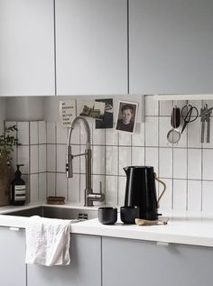 A light grey kitchen with white metro tiles - it's so hard to find a beautiful kettle but this design from Stelton is minimal, logo-free and has a lovely, tactile wooden handle