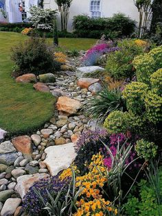 Front Yard Landscaping How to Install a Dry Creek Bed-Control the flow of rainwater across your landscape with an easy-to-install dry creek bed. - Control the flow of rainwater across your landscape with an easy-to-install dry creek bed. Landscaping With Rocks, Front Yard Landscaping, Dry Riverbed Landscaping, River Rock Landscaping, Cheap Landscaping Ideas, Farmhouse Landscaping, Landscaping Software, Wisconsin Landscaping Ideas, Burm Landscaping