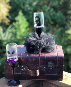 This sale is for a set of two black champagne flutes, with images and tutu skirt • Please do NOT use the Custom Order option unless we have spoken and created a customized order for you. The actual cost of Custom Orders depends on what customizations and the quantity you need Standard size flute glasses 8 X 2 (6 fl oz) This Jack and Sally inspired champagne glass set will stand out on your sweetheart table, reception table or other decor tables and for all your wedding party(great takeawa...