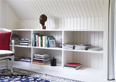 Built-in shelving for under a slanted roof