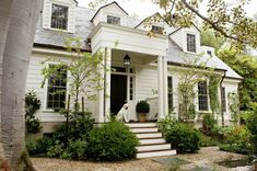 Fabulous white house by Tim Barber. Color is Benjamin Moore Swiss Coffee oc-45