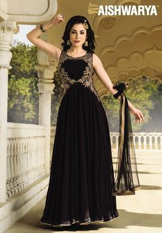 Dazzle with this long black anarkali with gold embroidery. Buy Anarkali Suit online - http://www.aishwaryadesignstudio.com/aishwarya%20exclusive%20suits/21319-long-dazzling-black-anarkali-suit.aspx