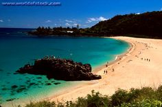 loved sitting on this beach in hawaii, while watching my new husband jump into the ocean back in 2006!