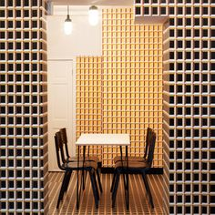 Eley Kishimoto adds optical-illusion wallpaper to London patisserie