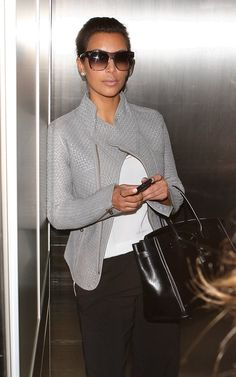 Never thought I would pin a Kardashian but love this look. Tom Ford sunglasses and love that grey jacket.