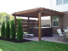 pergola with privacy screen, I would add section behind shrubs...the hot tub is nice too.