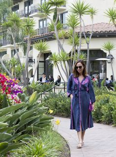Sydne Style shows what to wear on a resort vacation in line and dot kaftan