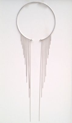 Tassel torc necklace by LAURA PAGLIERI-ES Silver, spinels and snake chain.