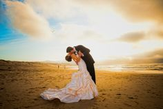 Groom and Bride kissing on the beach! What   a gorgeous picture!! Taken by: Expressive Photographics