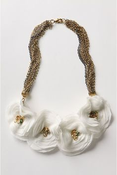 Anthropologie Floral Necklace ! Make your own, looks easy!  I would use old tshirts to make the flowers.  It's basically concentric circles pinned together with a few stitched and then add bling.