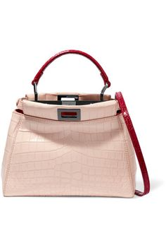Fendi's cult 'Peekaboo' bag is updated in a feminine blush hue for Fall '16. Crafted from smooth crocodile, this structured style is detailed with contrasting red top handle and an optional shoulder strap. The signature turn-lock fastenings open to two supple, leather-lined compartments with room for your everyday essentials - think wallet, cell phone and keys.
