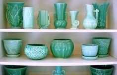 McCoy Pots with Saucers in turquoise, quite the collection!  Includes three that I have available in white.  Wow!   ~ Mary Walds Place -  McCoy pottery   dandybreadandcandy.blogspot.com/