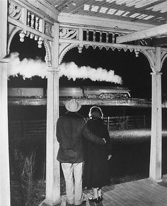 O. Winston Link, Mr. and Mrs. Ben Pope watch the last steam powered passenger train. Max Meadows, Virginia, 1958, 16 x 20 inch silver gelat...