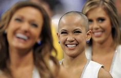 Colts cheerleaders Crystal Anne is all smiles despite having no hair after having her head shaved in honor of Colts head coach Chuck Pagano in the second half of the game on Sunday, November 25, 2012 at Lucas Oil Stadium. Colts Mascot Blue issued a challenge to the cheerleaders that if he could raise $10,000 for leukemia research by November 25 that someone would have to step up and get shaved. Not only did one step up to the challenge but a second cheerleader joined in for the cause. (Matt…