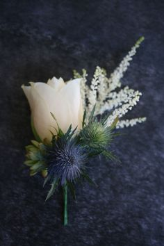 Button Hole for a Scottish Groom - sea holly, rose and lucky heather for Ross More