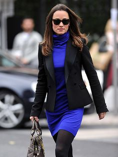 WHY SO BLUE? Working girl Pippa Middleton continues to flaunt her signature style in London on Thursday.