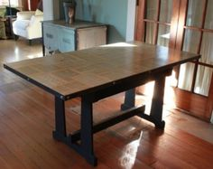 DIY Vintage Table With Dictionary Pages Top | Shelterness  ~could do this to so many furniture pieces, am thinking of pages from a favorite book perhaps.  wondering how necessary the metal stripping is~