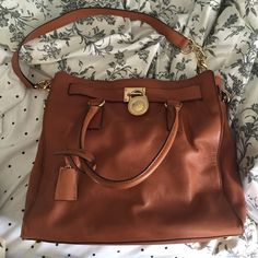 Michael Kors tan Hamilton bag Gently used and still in great condition. Only wear I noticed is where the lock attached to the bag as shown in the picture. Comes with a dust bag, purchased at a tj maxx so it is authentic but is past season. Michael Kors Bags Totes