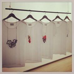 Cool way to display necklaces! Makes a statement, adds height to a craft fair booth and gives a clean, white background to each item