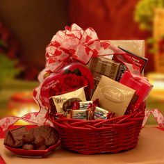 Nothing says #Happy #Valentine's #Day like #Chocolate. Melt their heart go pitter patter this year with a decadent assortment of mouth watering chocolates delivered in a sweet read #gift #basket topped with our petite #hearts handmade bow.