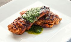 A very simple chicken recipe with a savory spice rub and a fresh parsley and mint sauce to top it all off.