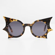 a031ed3c245a Bat-shaped sunglasses inspired by Peggy Guggenheim but modernised for a  more flattering look.