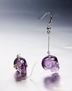When I first saw this on my phone it was very tiny and I thought they were purple glass hippos and I squealed out loud and I wanted them more than life itself... but they're not :/