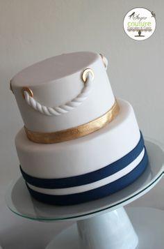 Nautical wedding cake, navy blue, gold and white.