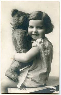 vintage photo of girl with her teddy bear