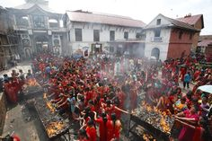 Women gather to light incense sticks and diyos (oil lamps) during the Teej festival in Pashupatinath Temple in Kathmandu. The festival is a three-day-long celebration that combines sumptuous feasts as well as rigid fasting. Through this religious fasting, Hindu women pray for marital bliss, the well-being of their spouses and children and purification of their own bodies and souls. (Shruti Shrestha/Reuters)