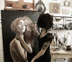 Charmaine Olivia painting in studio, incredible portraits with dark beauty