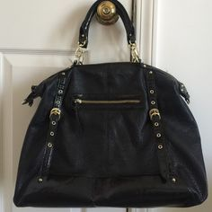 Black purse Black, non-leather, but from a very good quality leather like material, with gold accents. No issues/damages to outside. The shoulder string is not here/available. The inner material shows minor piling from usage, see picture. Priced accordingly. Steve Madden Bags Satchels