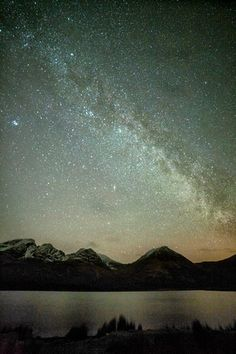 The Milky Way, seen here above the mountain of Bla Bheinn ( Blaven ) in the Cuillin mountain range on the Isle of Skye, Northwest Scotland.
