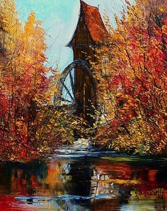 Old windmill and river with Autumn leaves to draw us into this vista.