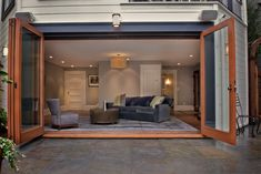 Folding doors don't take up too much space when opened, also allowing for a ceiling fan vs. garage door option.