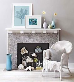Fireplace filled with coral and shells -  bhg