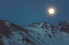 Full Moon rising over mountain peak in French ski resort Superdévoluy. You can license this photo exclusively at Stocksy United.