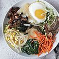 Bibimbap at Home | Bon Appétit  | January 2013 | By: Kay Chun | Buy thinly sliced beef at Korean markets, or ask your butcher to cut it for you. | Via: epicurious.com