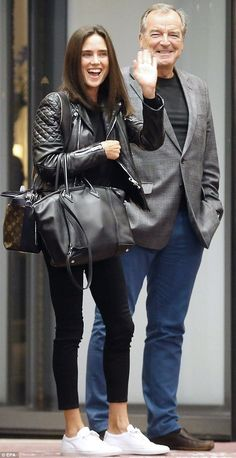 Happy days: Clad in a leather jacket and skinny jeans, the beauty carried her…