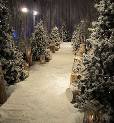 Snow White: David brought a storybook fantasy to life (and snow to LA!) for bride Sno E. and her handsome prince. The ceremony venue was transformed into an exquisite winter wonderland, complete with pine trees dusted with snow, logs, and romantic lanterns.
