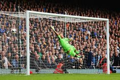 31 September 2013 Jaaskelainen is left clutching at air as Leighton Baines scores his first of the day with a well placed free kick