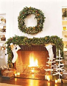 This wreath and hearth-framing garland are studded with red berries and gold ornaments and dappled with gold paint.